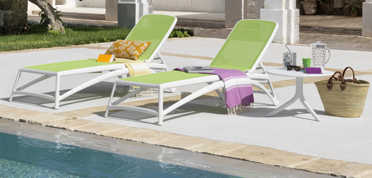 Relaxation on the sun  sunbeds and chaise longue