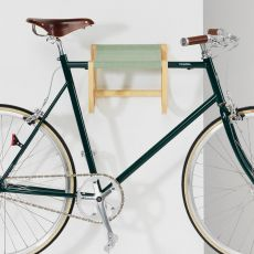 René - Wall-mounted bicycle storage in wood and fabric, available in different colours